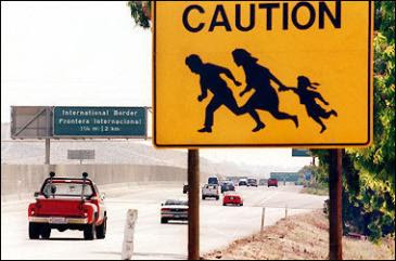 CautionSign-IllegalsCrossing