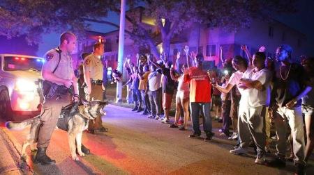 Ferguson, Missouri youth protest police killing, Aug. 9, 2014