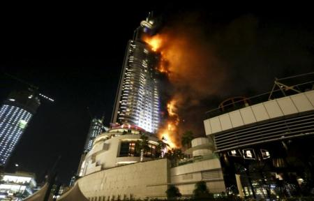 A fire engulfs The Address Hotel in downtown Dubai in the United Arab Emirates December 31, 2015. REUTERS/Ahmed Jadallah
